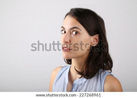 Head and Shoulders Portrait of a Woman with Dark Hair in Studio - stock photo