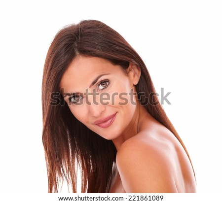 Head and shoulders portrait of adult beautiful female for skincare product smiling at camera on isolated studio