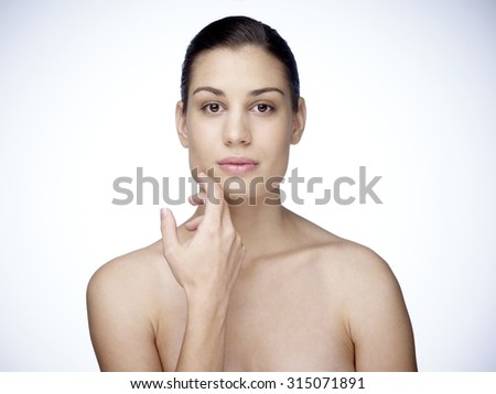 Head and shoulders portrait of an attractive young woman - stock photo