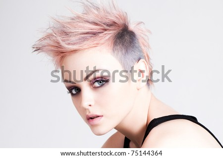 Head and shoulders portrait of an attractive young woman with wild pink hair. Horizontal shot. - stock photo