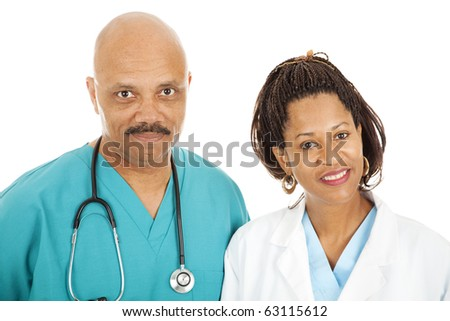 Head and shoulders portrait of caring, african-american doctors.  Isolated on white. - stock photo