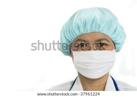 Head and shoulders portrait of Nurse with surgical mask and hair cap - stock photo