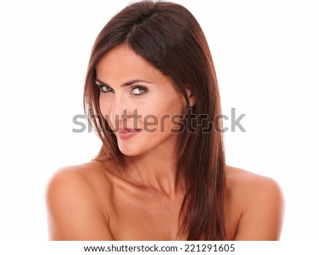 Head and shoulders portrait of pensive sexy woman looking at camera with sensual look on isolated white background