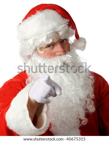 Head and shoulders portrait of Santa Claus pointing to viewer with a stern look.  Isolated on white.