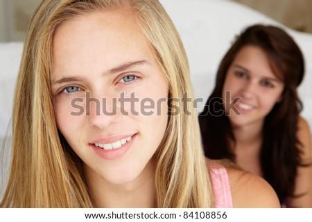 Head and shoulders portrait of teenage girls - stock photo
