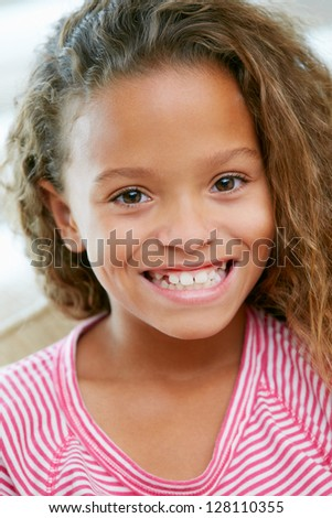 Head And Shoulders Portrait Of Young Girl - stock photo
