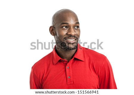 Head and shoulders studio portrait of a handsome black man in his late 20s smiling looking away isolated on white