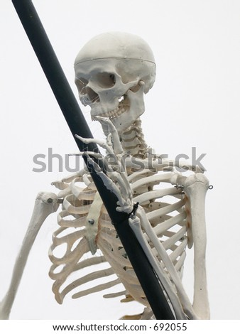 head and torso of grim Reaper with scythe in it's hand - stock photo