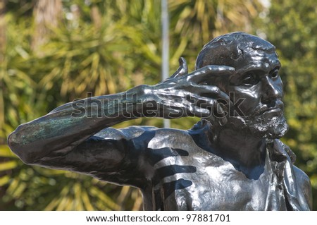 Head, arms and shoulders of the bronze statue Jaques de Wissant, 1888 by Rodin displayed in Murcia, Spain, in the open air with blue reflections from the blue sky  The Thinker. - stock photo