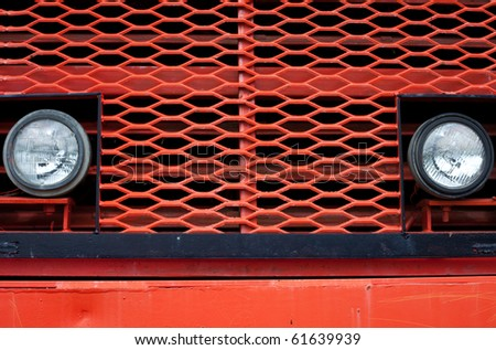 Head beam lamps and grill of vintage giant mining truck. - stock photo