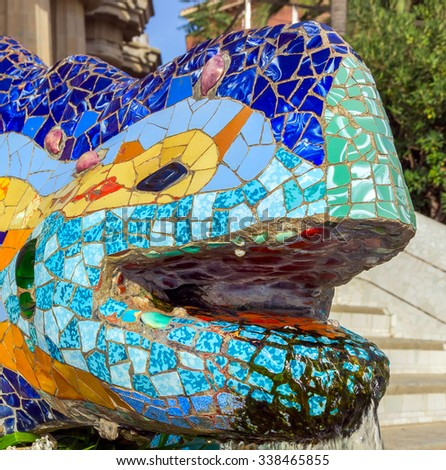 head dragon mosaic sculpture at the Parc Guell designed by Antoni Gaudi located on Carmel Hill - stock photo