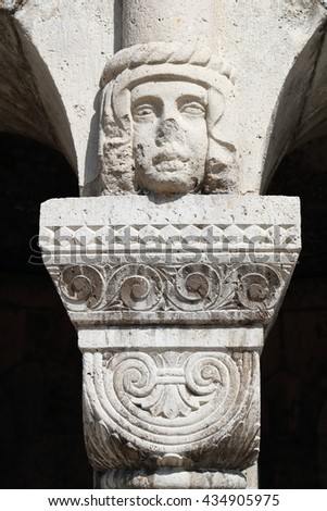 Head figure as the capital atop the column at the Fisherman's Bastion in Budapest, Hungary - stock photo