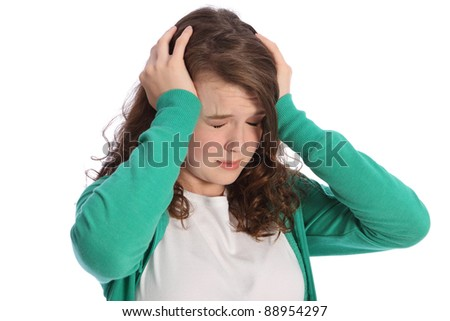 Head in hands for young teenager girl looking stressed and frightened with eyes closed. She is wearing a green hoodie and a sad expression on her face.