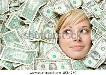 Head in Money - stock photo