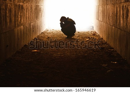 head in the tunnel waiting hands of underprivileged children alone - stock photo