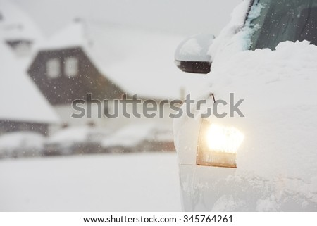 Head light of the car on winter road - stock photo