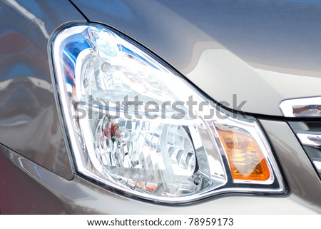 Head lights of a grey car - stock photo