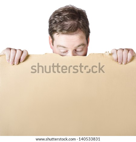 Head of a curious man peeking behind a blank cardboard sign, white copy space background - stock photo