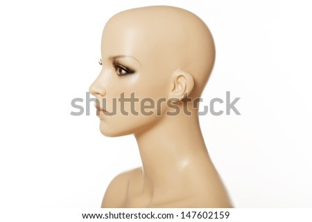 Head of a female mannequin in profile isolated on white - stock photo