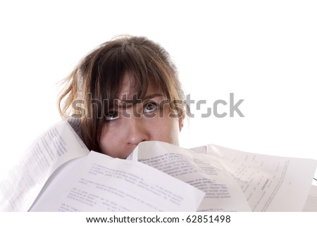 head of businesswoman sticking out of papers - stock photo
