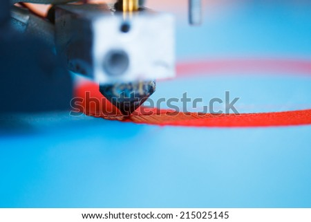 head of 3d printer in action - stock photo