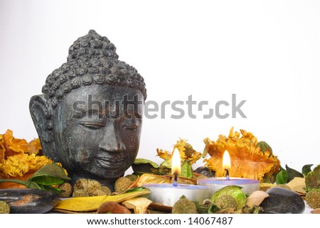 Head of god with candles and dry flowers - stock photo