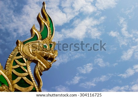 Head of naka statue on blue sky - stock photo