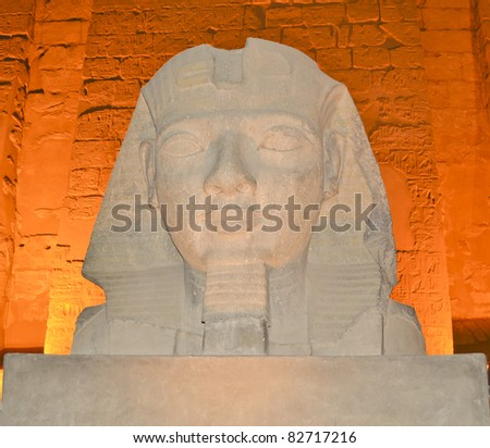 Head of Ramses II lit up at night in Luxor Temple - stock photo