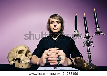 head of the sect was sitting at the table - stock photo