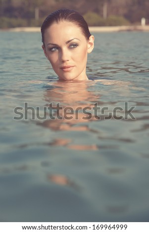 Head of the woman swimming at the summer beach