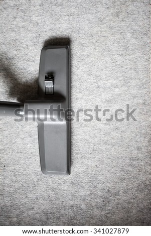 Head of Vacuum cleaner on carpet from top view