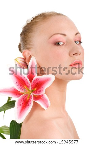 Head of young attractive woman with lily on isolated background - stock photo