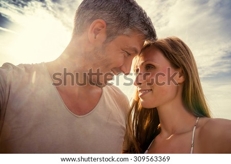 head on head selfie while looking each other - stock photo