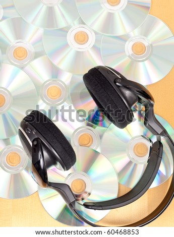 Head Phones and Scattered Music CD's - stock photo