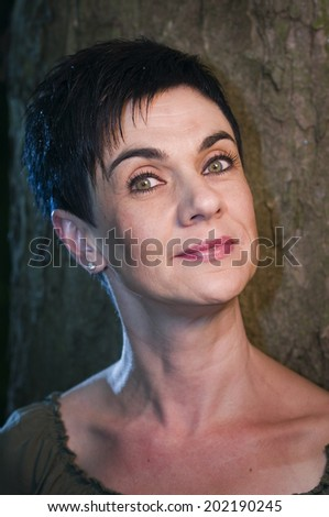head portrait by the tree - stock photo