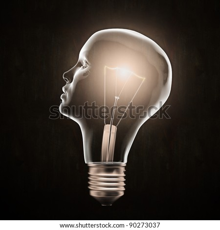 Head shaped light bulb - creativity concept - stock photo