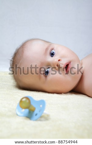 head shoot of cute baby with blue eyes and suprise look - stock photo