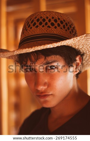 Head shot of a cowboy  outside in the home - stock photo