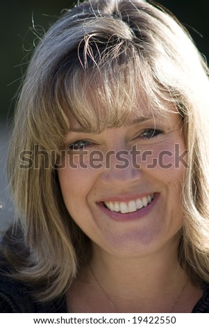 Head shot of a smiling soccer mom