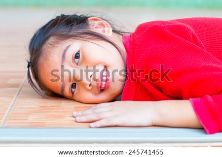 Head shot of beautiful asian girl in red suit at Chinese temple, Thailand. - stock photo