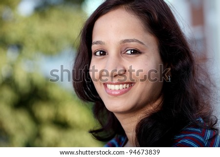 Head shot of cheerful female college student