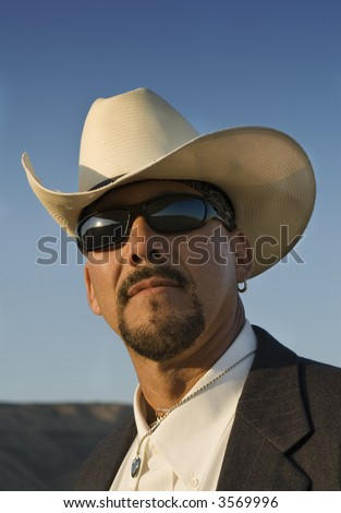 Head shot of Hispanic male with cowboy hat