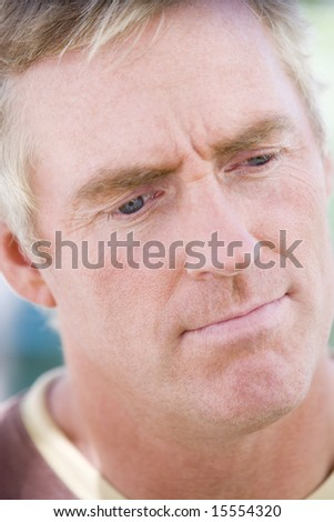 Head shot of man thinking - stock photo