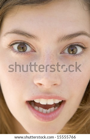 Head shot of surprised woman