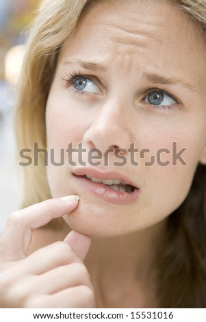 Head shot of worried woman