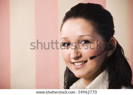 Head shot of young woman customer service smiling and looking at camera ,copy space for text message in left part of image,vertical blinds background - stock photo
