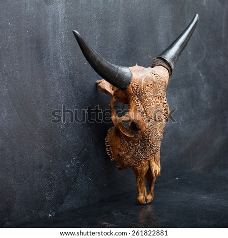 head skull of bull on the background  textured walls.  - stock photo