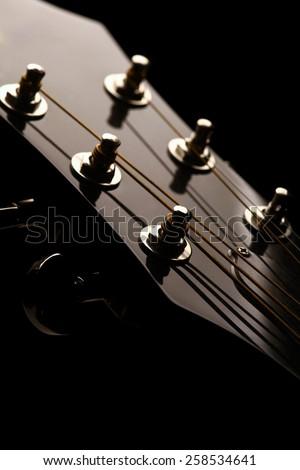 Head stock of a dark solo guitar. - stock photo