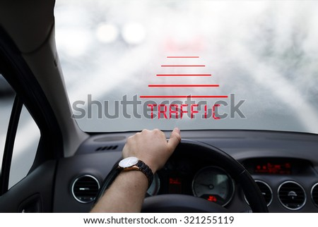 Head-up system technology in car in foggy morning - stock photo