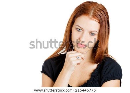 Headache and Stress at work. Portrait young gloomy woman stressed, tired, looking down, depressed, isolated white background with copy space. Negative human emotions, face expressions, feelings - stock photo